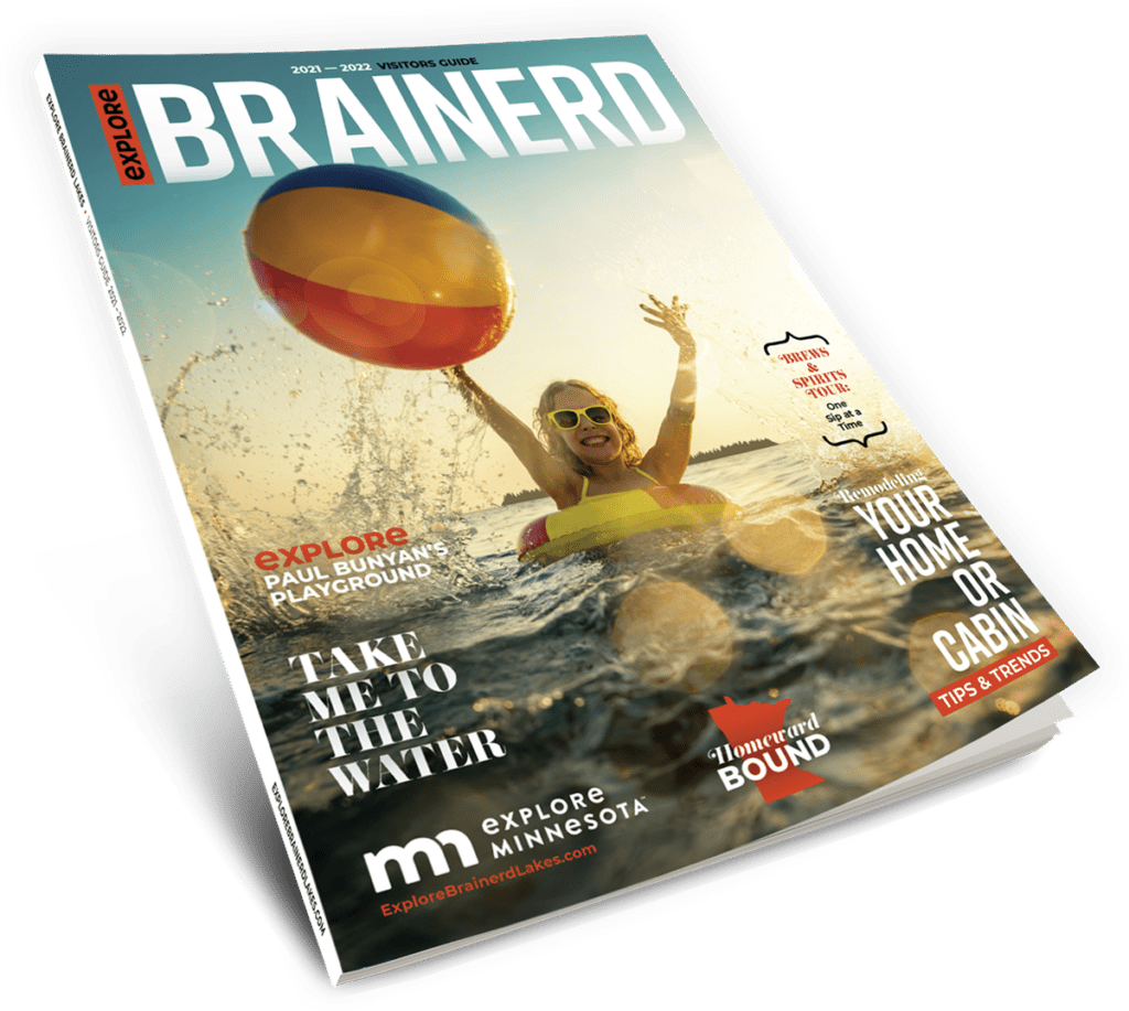 Explore Brainerd Lakes 2021 Visitor Guide Cover with photo of young girl swimming in a lake and playing with a beach ball